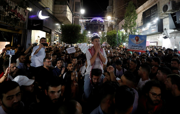 Palestinians take part in a protest demanding to lift the sanctions on Gaza Strip, in Ramallah, in the occupied West Bank